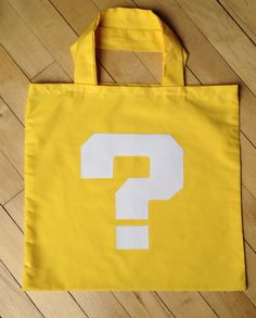 TA: get a big yellow tee and add a white question mark. Wear it over the carrier. Mario Costume Diy, Mario Cosplay, Twin Halloween, Halloween Bags, Family Halloween Costumes, Super Mario Birthday, Super Mario Party, Diy Mario Birthday Party Ideas, Ideas