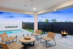 You'll be spending all your time outside with this G. Gardner Homes outside alfresco. With space to sit and relax, as well as the sleek look of a glass gated pool, this backyard has it all. Outdoor Living Areas, Outdoor Rooms, First Home Owners, Modern Contemporary Homes, Custom Home Designs, New Home Construction, Custom Built Homes, Display Homes, Building A New Home
