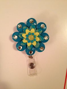 One of many ID badges made from medicine vial caps,buttons, and jewels...