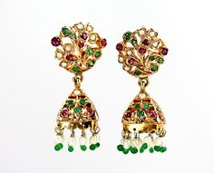 12K gold pierced earrings set with seed pearls, faceted rubies, and emeralds. Total weight: 19 grams. No maker's mark. Acid tested. Gems tested. Carat weight unavailable. One emerald has a tiny chip.