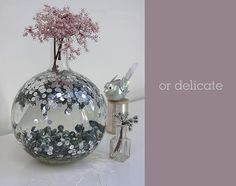 "So clever- ""I simply tipped a bag of silver plastic sequins into the empty vase using a funnel and then topped the vase up with water. Some sequins floated and some sank""- Sania Pell"