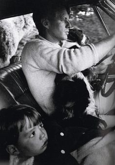 Bobby Kennedy driving with his son, Max, and dog, Freckles. Another dog is in the backseat.