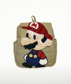 Super Paper Plumber ( Inspired by Super Mario Bros ). $84.99, via Etsy.