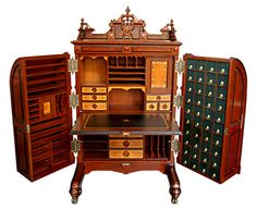 WOOTON DESK - The Victorian version of the iPhone was an ingenious, multi-holed secretary desk. These elaborate desks were designed and patented by William S. Wooton during the late 19th century.
