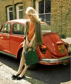 Girl and her red VW Beetle