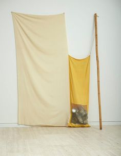 Robert Rauschenberg  (United States of America 1925–2008)    Title  Nugget, from the series Jammer  Year  1976  Media  Installation  Medium  fabric, bamboo pole, string, tin cans