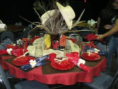 Western Table I decorated for a Mother's Day Women's Conference at our Church.  I used Zack's Colored boots and his hats from when he was little.