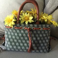 Dooney & Bourke Tiny Tassel Tote Very cute tote!!! Has been gently used with minor corner damage (see pic 3 for most obvious corner). Bag is very clean and materials are sturdy 👍🏽💕🤗 Dooney & Bourke Bags Totes