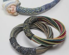amanda caines - idea for bracelet - extruded snakes with a polymer cuff connecting them and maybe a magnetic clasp?