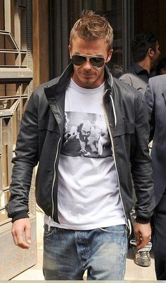 Beckham...rocking a tshirt with Allen Ginsberg on it. He boosted himself up a notch in my book. Even more so if he actually knows who he is.