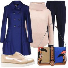 Il cappotto blu oltremare, modello a doppiopetto leggermente svasato, si abbina al maglione color sabbia con il collo ad anello. I classici pantaloni 7/8 sono in misto lana. La borsa messenger è in vera pelle ed ha il manico removibile. Scarpe stringate in pelle.