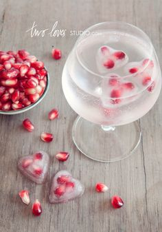 heart-shaped ice cubes made with pomegranate seeds
