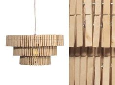 DIY: Clothespin Chandelier    From Julie January 19, 2011    Noticed recently: clothespin light fixtures (in Jamin Puech's Paris shop and at 15th Avenue Coffee & Tea in Seattle); we think they'd be equally at home in the domestic laundry room.    Above: A Clothespin Sculpture by Ariel Rose of Sweet Spontaneous.      Above: The Bride light by Tel Aviv-based design collective Mesila is made from clothespins clipped onto an iron frame; via Design Milk.    Above: A clothespin light fixture at…