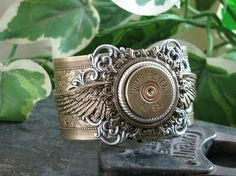 Shotgun Casing Jewelry - Bullet Casing Jewelry - Winchester 12 Gauge Shotgun Shell Steampunk Inspired Mixed Metal Cuff Bracelet by priscilla SERIOUSLY?! this is f-ing sweet! I love shooting all guns but a 12 guage shotgun...that's my fav! <3 <3 <3 clay bird shooting...that is what us girls did with my father for fathers day..plus boating ;)