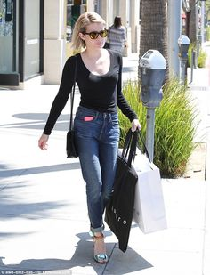 Retail therapy: Emma Roberts went casual in jeans and a black top while shopping at Sandro in Beverly Hills on Monday