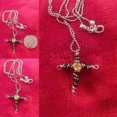 Small beaded cross with silver colour wire and gold colour swirls in centre. Delicate and small.