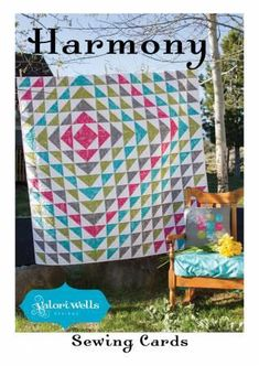 "A combination of flying geese and half-square triangles in an off-center design make this 60"" x 60"" quilt made with 1 1/2"" strips."