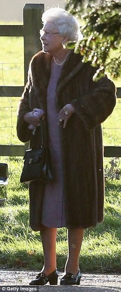 Vintage glamour: The Queen arrives for a Christmas Day service at The Church of St Mary Magdalene on the Sandringham Estate in Norfolk in a fur coat she has owned since 1961