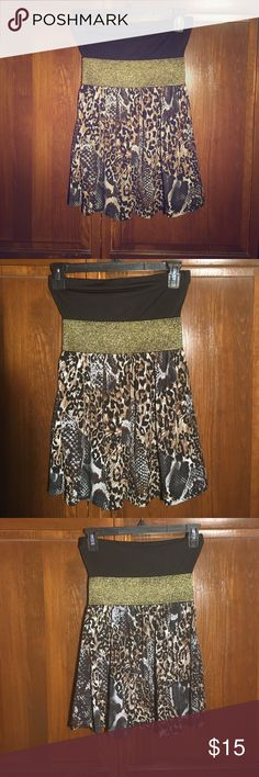 Strapless Animal Print Black and Gold Club Top S Strapless Animal Print Black and Gold Club Top Small. 95% Polyester 5% spandex Rue 21 Tops Blouses