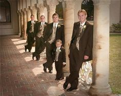 Groom's Idea:  Chocolate Tuxs for the groomsmen, best man, and ring bearer...  Maybe burgendy vest and tie for the best man, and dark purple for the rest?