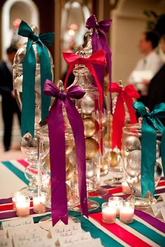 Gorgeous!  Apothecary Jars filled with ornaments, tied with satin ribbon in jewel tones