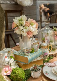 Fairytale fans, we've got a treat for you! This Alice in Wonderland wedding style shoot brings all our favourite imaginative elements of the beloved story. Tea Party Wedding, Wedding Book, Wedding Table, Alice In Wonderland Tea Party Birthday, Alice Tea Party, Alice In Wonderland Theme, Moss Centerpiece Wedding, Tea Party Table, Tea Tables