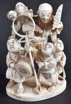 LATE 19TH CENTURY JAPANESE MEIJI PERIOD IVORY OKIMONO carved with children, figures and monkey. Signed. Minor faults. 3.75ins high.