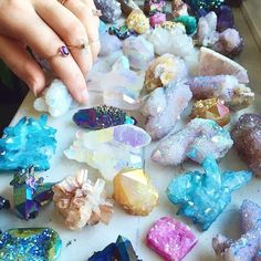 Candy Crystals! These are called Aura Quartz Crystals. Most high quality specimens undergo a vapor treatment that gives them these incredible mystical prism colors! They are 100% natural quartz. I can never resist these pretty little guys! I have several