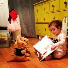 I caught her reading to her kangaroos tonight. She points at the words for them and shows them all the pictures!: