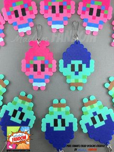 Our pixel style Trolls Party Favors are a MUST for your party! Completely handmade from original Madam FANDOM Pixel Art, each character is topped off with your choice of a Zipper Pull (ideal for clipping to backpacks, purses, etc), magnet, or pin. Each Troll is handmade using absurdly