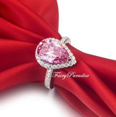 We believe that everyone should have a chance to experience the joy brought from the fine jewelries.  Style Description: Victoria style, Pear Cut synthetic pink sapphire and lab made Diamond, Brillian