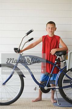 b943f477081 Stock photo of Boy with Bicycle; Premium Rights-Managed, © Raymond Forbes /  Masterfile. All rights reserved.