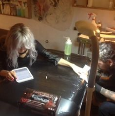 Lou getting her tattoos