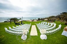 Seating in the half circle for outdoor wedding ceremony. Rent the White chairs