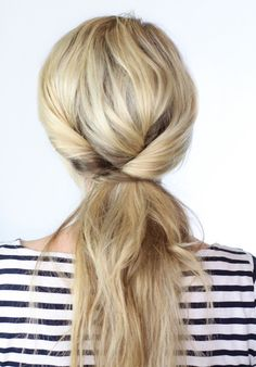 Triple Twisted Ponytail: Ever feel like your hair has a mind of its own? When you're short on time and the hair's being stubborn, let it do it's thing. Tease a little, twist a little and voila! You're beautiful! (via Twist Me Pretty)