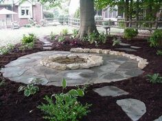 Flagstone Patio Around Natural Stone Fire Pit