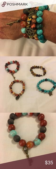 Handmade set of four beaded bracelets Handmade gorgeous beaded bracelets. Set of four bracelets one is plain, one has a butterfly on it, one has a key on it, one has a gear on it. Stunning to wear together or just one Jewelry Bracelets