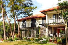 The home's facade is a charming sight. Framed by trees and a sprawling landscape, the house's relaxing rural vibe welcomes one to the Sanchez family home. Filipino Architecture, Philippine Architecture, Architecture Design, Real Living Magazine, House And Home Magazine, Modern Filipino House, Tropical Houses, Tropical Plants, Spanish Colonial Homes