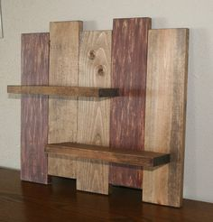 Reclaimed Rustic Distressed Wood Wall Shelf Rustic Wood Shelf Width- 17.5 Height- 16.5 Top shelf is 10 long. 2nd shelf is 10.5 long. This distressed/ primitive wood shelf has been sanded, painted and stained displaying Burgundy and Brown stain colors. We can do custom sizes upon
