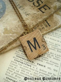 Vintage SCRABBLE Letter M Necklace. Lovely Old Wood Tile Initial Wrapped in Antiqued Brass Filigree. Monogram Necklace. Rustic Jewelry.. $24.50, via Etsy.