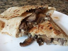 21 Day Fix Lunch Idea • Sautee 1 red container of sliced leftover steak with 1 green of mushrooms using non stick cooking spray. • spread 1 Blue container of hummas on whole wheat wrap (yellow) add a little dijon mustard and wrap up. • pan sear wrap to make it crunchy.  1 red • 1 Yellow • 1 Green • 1 Blue