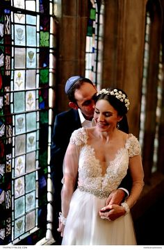 A Jewish couple shared a sweet embrace after their wedding ceremony in a Cape Town synagogue. | Photographer: Justin Davis Photography | Wedding Dress Designer: Casey Jeanne | Headband: Heike le Cordeur
