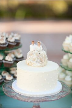 We love this vintage style bride and groom wedding cake topper!