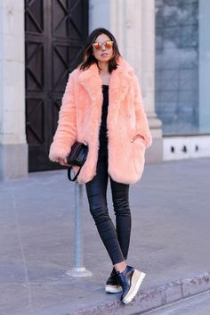 20 Looks with Fur Coats Glamsugar.com Winter Street Style Outfit bright salmon-colored fur coat styled with orange mirrored sunglasses and platform shoes