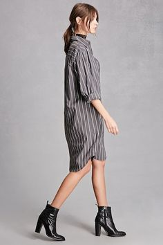 A woven oversized shirt dress featuring a pinstripe print, a buttoned front closure, a basic collar, long sleeves with buttoned cuffs, and a curved hem. This is an independent brand and not a Forever 21 branded item. (This item runs small, please size up.)