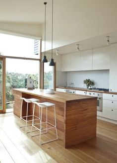 Timber Kitchen with great pendant lights and stools. Messmate Timber Island bench.