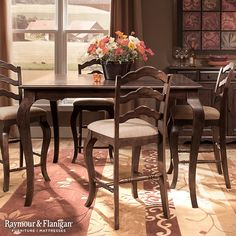 This elegant new Rosemont Dining Set features a splendid cherry finish with decorative accents at every turn. You'll love the scalloped table skirt, matching arched stool backs and turned stretchers, not to mention the luxe chenille seats.