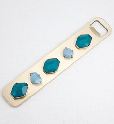 KELLY WEARSTLER | BEJEWELED BOTTLE OPENER. Pyrite and rutilated quartz in unlacquered brass