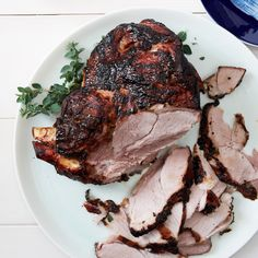 This delicious pork shoulder is marinated in citrus juices with garlic, oregano and cumin, then slow-roasted over indirect heat on a charcoal grill.