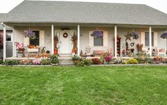 Love the flowers and porch!  eclectic porch by Julie Ranee Photography